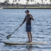 paddling a wooden paddle board